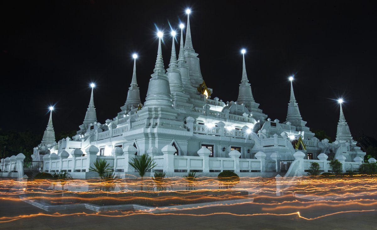 n Samut Prakan, Thailand, a custom involves Buddhist monks circling the Wat Asokaram temple with candles.
