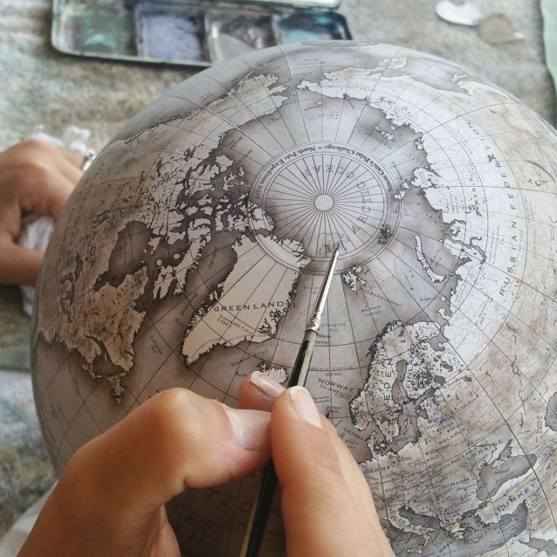 Adding a tiny illustration of a polar bear - One Of The World's Last Remaining Globe-Makers That Use The Ancient Art Of Making Globes By Hand