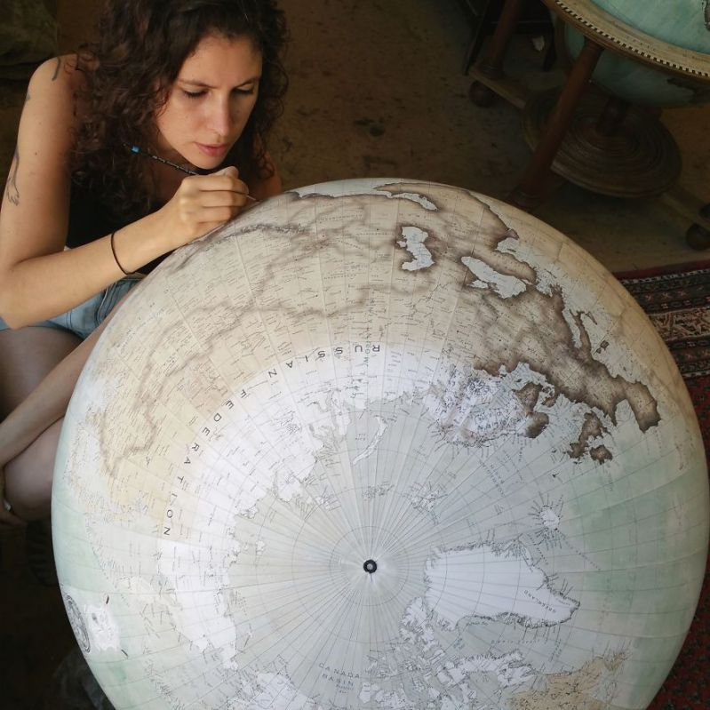 Isis started painting around the coastlines in England and is working her way around Cambodia, Vietnam & towards the Americas - One Of The World's Last Remaining Globe-Makers That Use The Ancient Art Of Making Globes By Hand