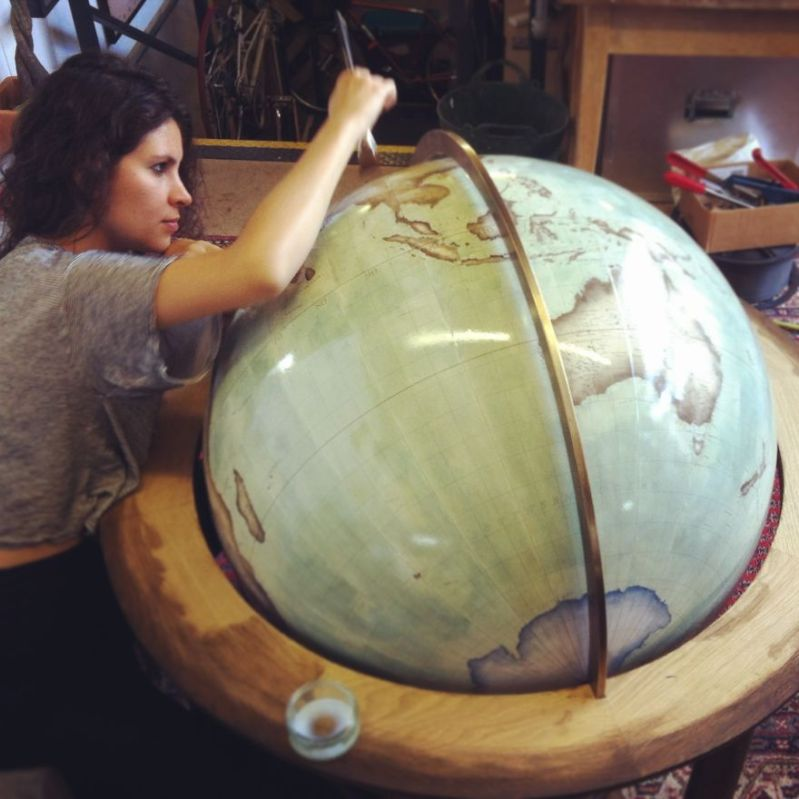 Varnishing an 80cm globe - One Of The World's Last Remaining Globe-Makers That Use The Ancient Art Of Making Globes By Hand