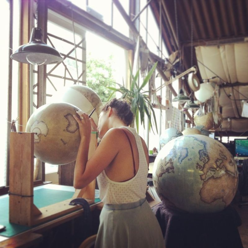Varnishing a finished globe that will then go onto a handcrafted wooden base - One Of The World's Last Remaining Globe-Makers That Use The Ancient Art Of Making Globes By Hand