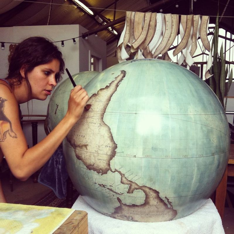 Painting final details - One Of The World's Last Remaining Globe-Makers That Use The Ancient Art Of Making Globes By Hand