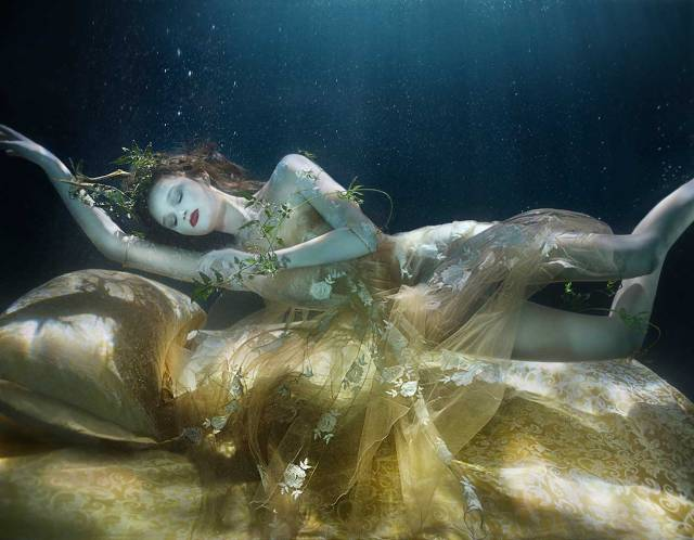 Golden Sleeping Beauty, underwater womens fashion editorial for